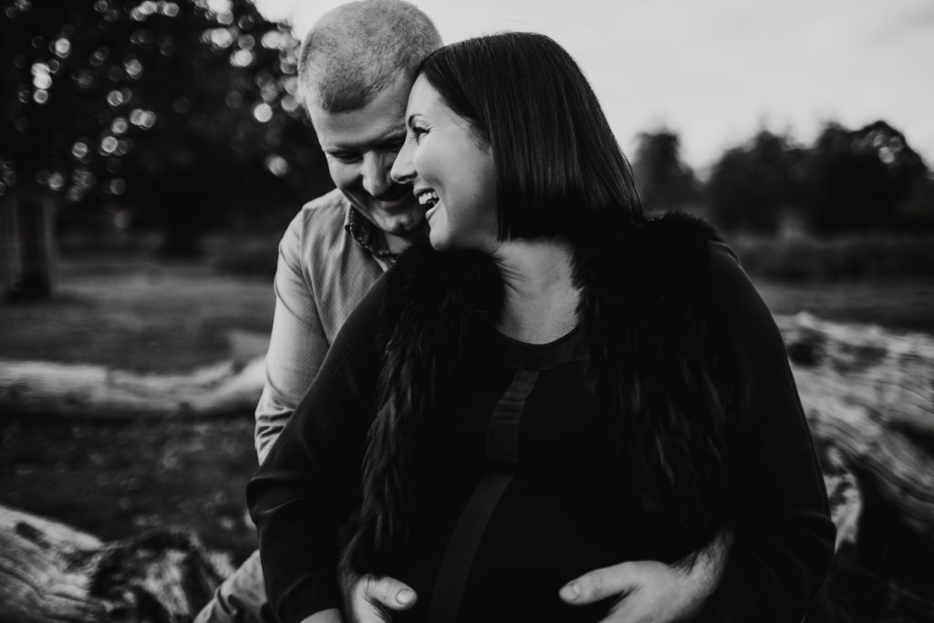 black and white image of pregnancy couple